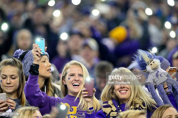 Washington fans through out the stadium lifted there cell phones in the air with the cell phone light on giving it a Fire Fly effect during the third...