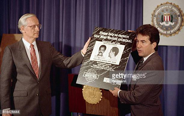 FBI Director William Sessions receives a poster of the most wanted criminal from John Walsh who will be the host of a new TV program on Fox...