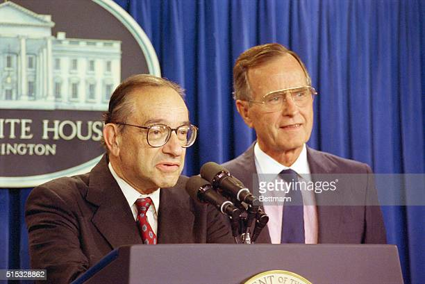 Federal Reserve Board Chairman Alan Greenspan speaks to the press after being reappointed by President Bush to a second fouryear term