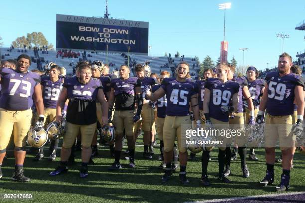 Washington football players sing the school fight song 'BOW DOWN TO WASHINGTON' to fans after there victory over the UCLA Bruins on October 28 2017...
