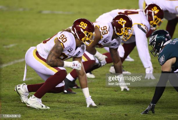 Washington Football Team Defensive End Chase Young readies for a play in the second half during the game between the Washington Football Team and...