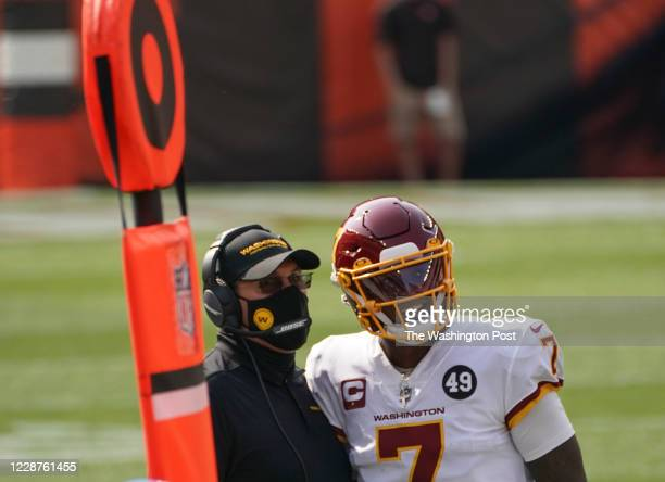 Washington Football Team head coach Ron Rivera and Washington Football Team quarterback Dwayne Haskins watch a replay after the Cleveland Browns...