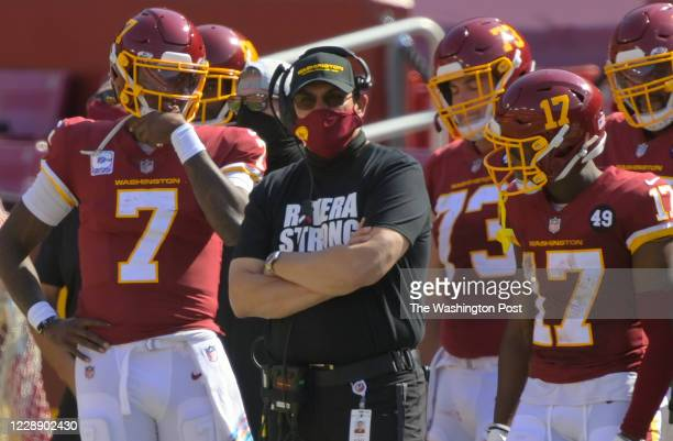 Washington Football Team head coach Ron Rivera, center, is sandwiched by quarterback Dwayne Haskins , left, and center Chase Roullier , and wide...