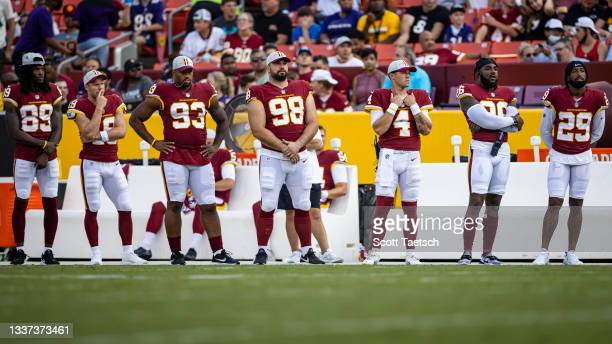 Washington Football Team players watch play during the first half as they sit out of the preseason game against the Baltimore Ravens at FedExField on...