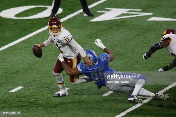 Washington Football Team quarterback Alex Smith is sacked by Detroit Lions defensive end Romeo Okwara during the first half of a regular season game...