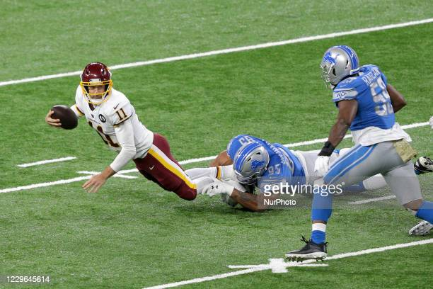 Washington Football Team quarterback Alex Smith is sacked by Detroit Lions defensive end Romeo Okwara during the first half of an NFL football game...