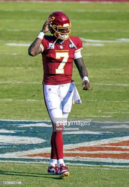 Washington Football Team quarterback Dwayne Haskins walks to the sidelines during the Baltimore Ravens game versus the Washington Football Team on...
