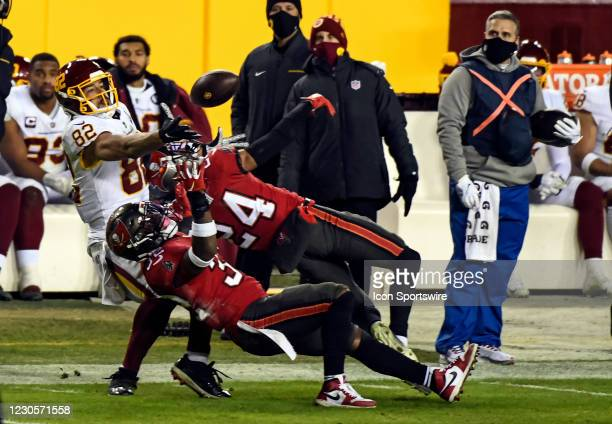 Washington Football Team tight end Logan Thomas fights for a reception against the defense of Tampa Bay Buccaneers safety Mike Edwards and cornerback...