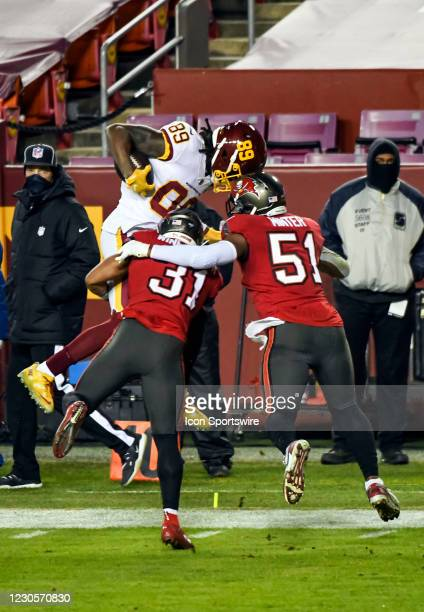 Washington Football Team wide receiver Cam Sims makes a reception against the defense of Tampa Bay Buccaneers strong safety Antoine Winfield Jr. And...