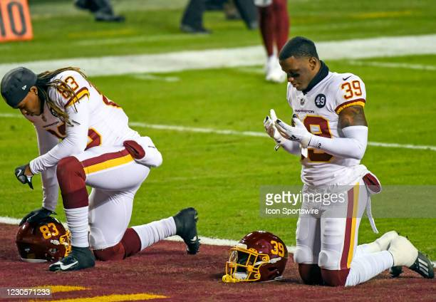 Washington Football Team wide receiver Isaiah Wright and free safety Jeremy Reaves kneel in the end zone prior to the Tampa Bay Buccaneers Wild Card...