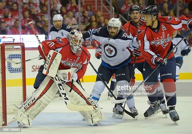 Washington goalie Braden Holtby left catches a put to make a save as the Washington Capitals play the Winnipeg Jets at the Verizon Center in...