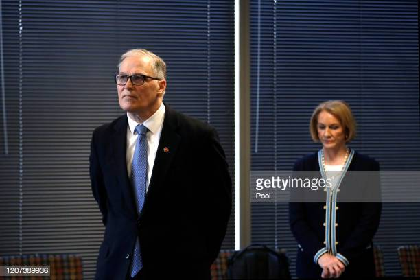 Washington Gov. Jay Inslee, left, and Seattle Mayor Jenny Durkan keep a social distance at a news conference about the coronavirus outbreak Monday,...