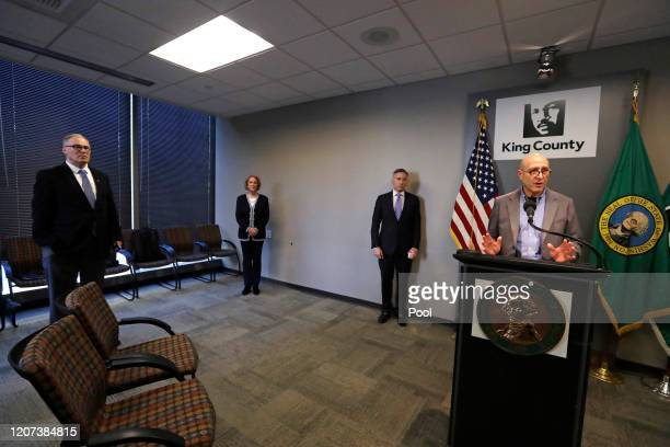Washington Gov. Jay Inslee, left, maintains a social distance as Seattle Mayor Jenny Durkan,King County Executive Dow Constantine look on as Dr. Jeff...