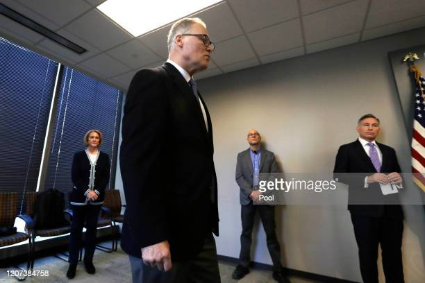 Washington Gov. Jay Inslee, second left, maintains a social distance as he steps forward to answer a question as Seattle Mayor Jenny Durkan, left,...