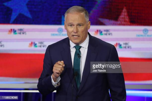 Washington Gov Jay Inslee speaks during the first night of the Democratic presidential debate on June 26 2019 in Miami Florida A field of 20...