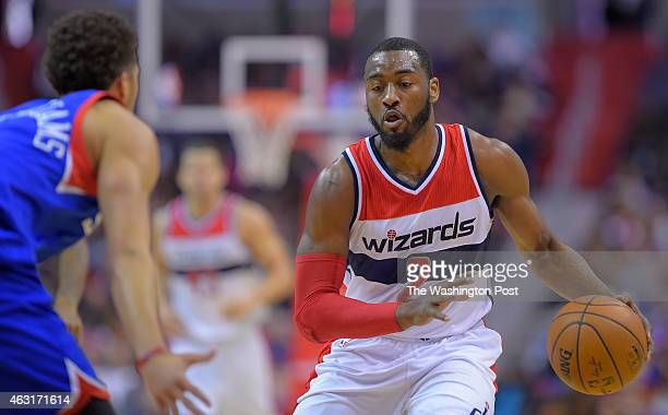 Washington guard John Wall right during the Washington Wizards defeat of the Philadelphia 76er's 111 76 at the Verizon Center in Washington DC...