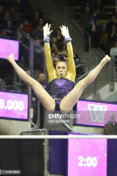 Washington gymnast Geneva Thompson performs her routine on the uneven bars during a women's college gymnastics meet between the UCLA Bruins and the...
