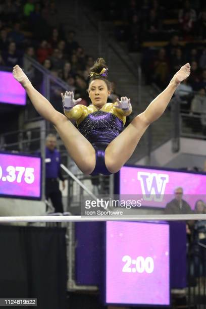 Washington gymnast Michaela Nelson performs her routine on the uneven bars during a women's college gymnastics meet between the UCLA Bruins and the...