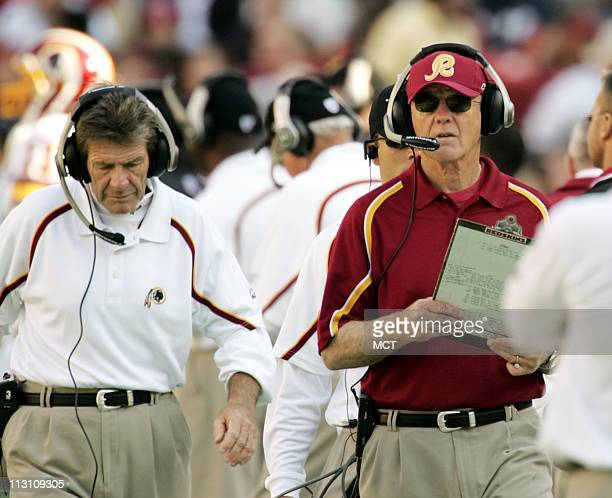 Washington head coach Joe Gibbs right and Joe Bugel left Assistant head coach offense look on from the sidelines during the Redskins 5217 victory...