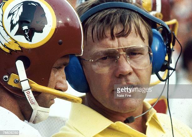 Washington head coach Joe Gibbs talks with Redskins quarterback Joe Theismann during a 2113 win over the Tampa Bay Buccaneers in Tampa Stadium on...