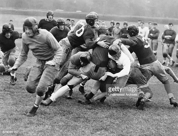 Washington High School running back Leo 'Legs' Leggett squirms through a hole in the line for a short gain San Francisco California August 30 1937