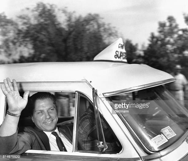 Washington: Hoffa Acquitted. Teamster vice president James R. Hoffa waves from a cab while leaving District Federal Court here today, after a jury...