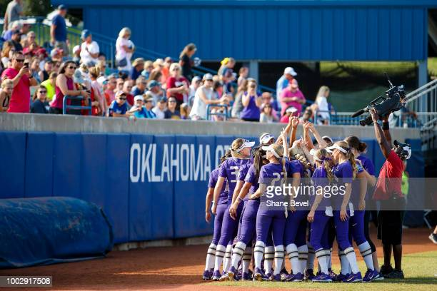 Washington huddles prior to game one of the Division I Women's Softball Championship held at USA Softball Hall of Fame Stadium OGE Energy Field on...