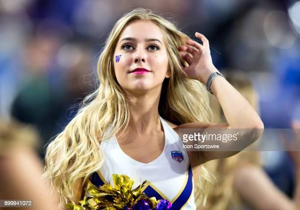 Washington Huskies cheerleader looks on during the PlayStation Fiesta Bowl college football game between the Washington Huskies and the Penn State...