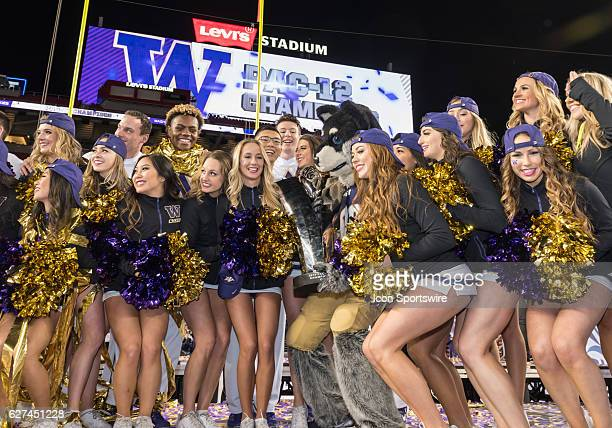 Washington Huskies cheerleaders and mascot pose with the PAC12 trophy during the Pac12 Championship game between the Washington Huskies verses the...