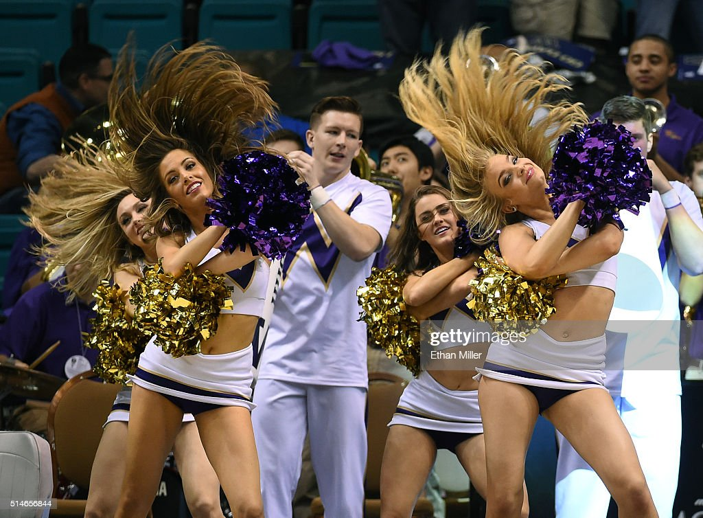 Washington Huskies cheerleaders perform during a first-round game of the Pac-12 Basketball Tournament against the Stanford Cardinal at MGM Grand Garden Arena on March 9, 2016 in Las Vegas, Nevada. Washington won 91-68.