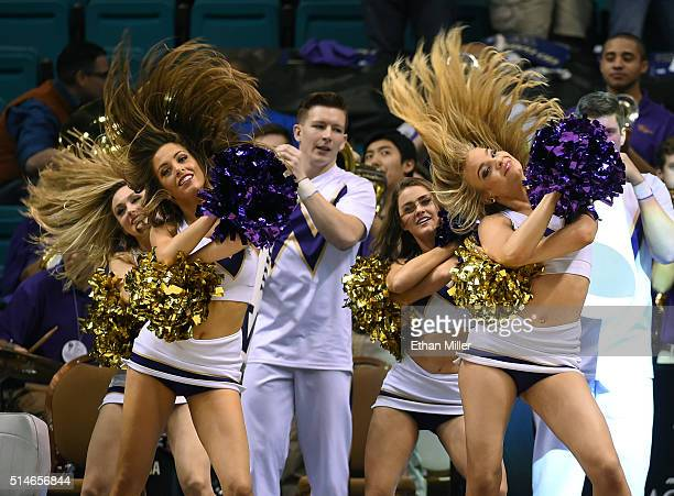 Washington Huskies cheerleaders perform during a firstround game of the Pac12 Basketball Tournament against the Stanford Cardinal at MGM Grand Garden...