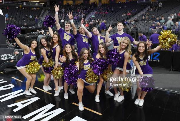 Washington Huskies cheerleaders pose before a quarterfinal game of the Pac-12 basketball tournament against the USC Trojans at T-Mobile Arena on...