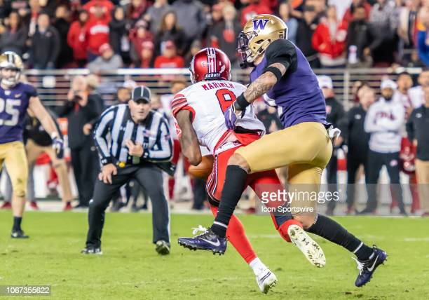 Washington Huskies defensive back Byron Murphy reaches in behind Utah Utes wide receiver Siaosi Mariner to strip the ball during the game between the...