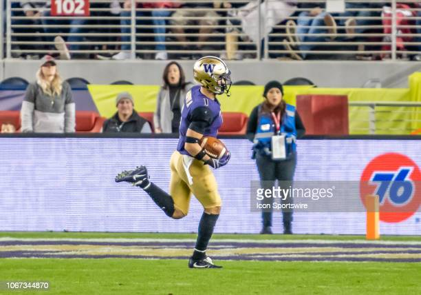 Washington Huskies defensive back Byron Murphy takes the ball into the end zone for the only touchdown during the game between the Washington Huskies...