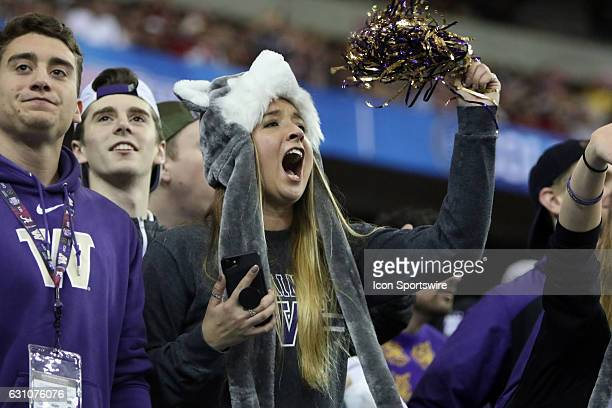 Washington Huskies fans at the College Football Playoff Semifinal at the ChickfilA Peach Bowl between the Washington Huskies and the Alabama Crimson...