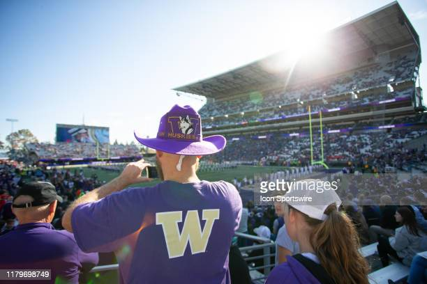 Washington Huskies fans get ready for the players to run on to the field before a game between the Washington Huskies and the Utah Utes on Saturday...