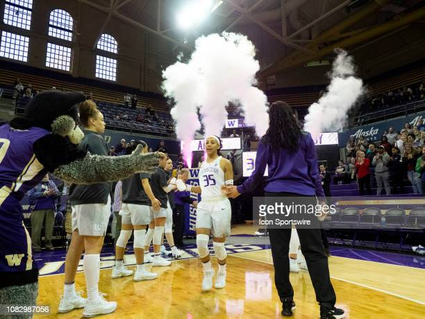 Washington Huskies guard Alexis Griggsby takes the court before a college basketball game between the Utah Utes against the Washington Huskies on...