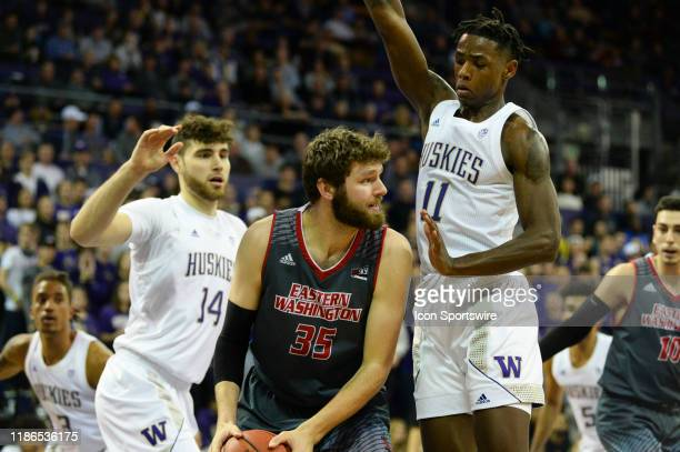 Washington Huskies guard Nahziah Carter defends against Eastern Washington Eagles forward Tanner Groves during college basketball game between the...