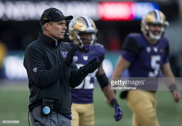 Washington Huskies head coach Chris Petersen cheers on his team during a football game against the Washington State Cougars at Husky Stadium on...