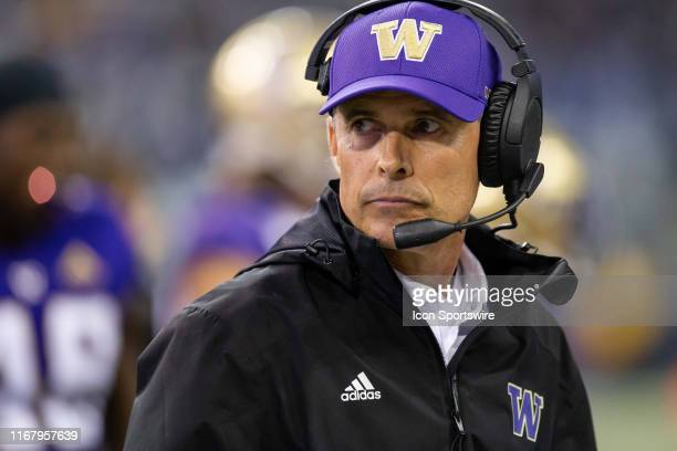 Washington Huskies head coach Chris Petersen paces along the sidelines during the fourth quarter of a game between the Washington Huskies and the...