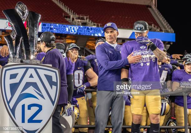 Washington Huskies head coach Chris Peterson waits with Washington Huskies defensive back Byron Murphy for the awards presentation after the game...