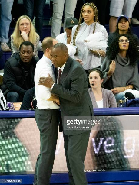 Washington Huskies head coach Mike Hopkins and Washington State Cougars head coach Ernie Kent shakes hands after a Boeing Apple Cup Series college...