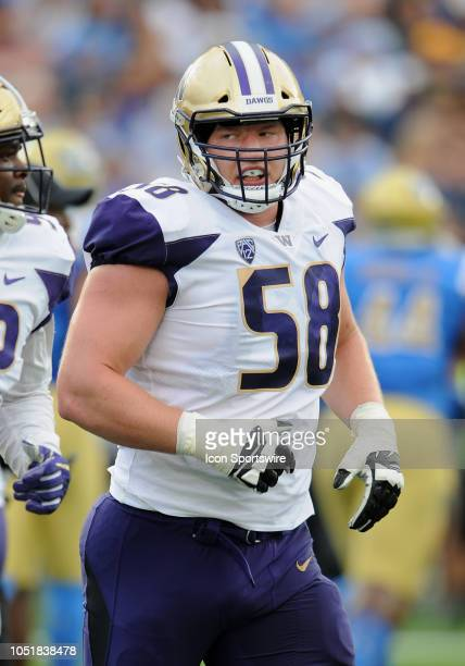 Washington Huskies offensive lineman Kaleb McGary heads off the field after a Huskies touchdown in the first quarter of a game against the UCLA...