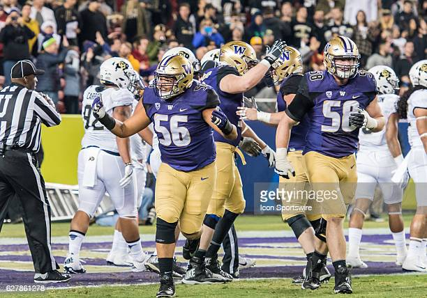 Washington Huskies offensive lineman Nick Harris and Washington Huskies offensive lineman Kaleb McGary come off the field after a successful scoring...