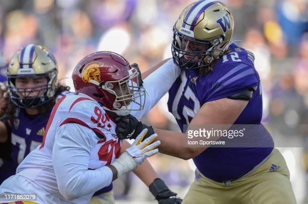 Washington Huskies offensive lineman Trey Adams blocks USC Trojans defensive lineman Drake Jackson during a PAC12 Conference game between the...