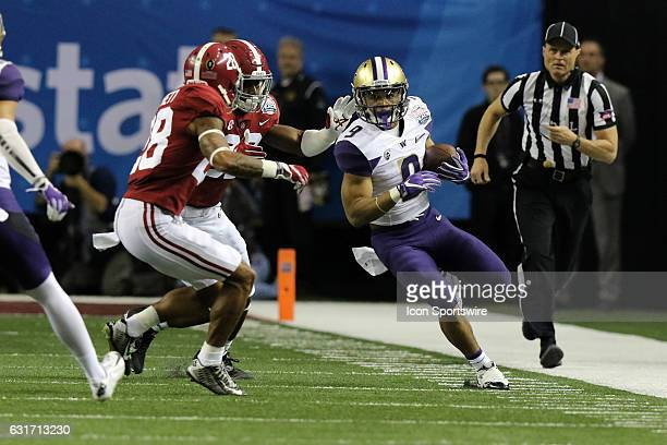Washington Huskies running back Myles Gaskin carries the ball in the College Football Playoff Semifinal at the ChickfilA Peach Bowl between the...