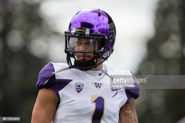 Washington Huskies safety Byron Murphy listens to the coach before the University of Washington Spring Game at Husky Stadium on Saturday April 21...