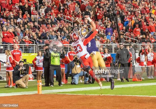 Washington Huskies tight end Cade Otton goes up for a pass in the end zone only to be broken up by Utah Utes defensive back Julian Blackmon during...