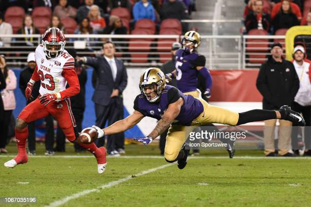 Washington Huskies tight end Hunter Bryant dives but cannot complete the catch under pressure from Utah Utes defensive back Julian Blackmon during...