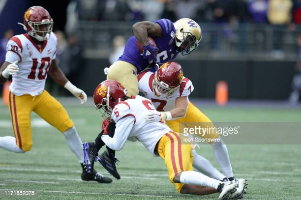Washington Huskies wide receiver Chico McClatcher is tackled after a short gain by USC Trojans cornerback Isaac Taylor-Stuart and USC Trojans...